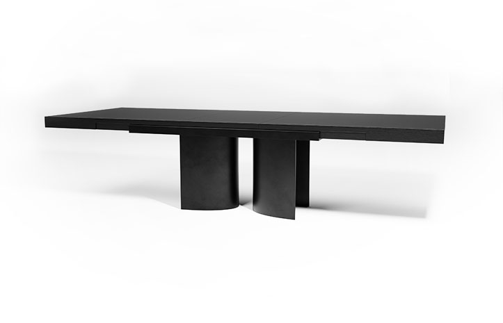 Silo Grip Extension Dining Table by LUMA Design Workshop shown in Ultra Clear Cast Glass. Custom furniture handmade in Seattle, WA.